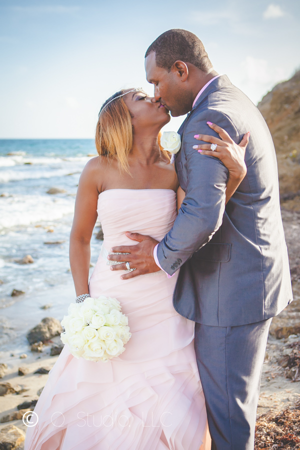 bride and groom kiss on St. Croix beach