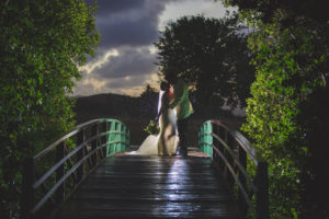 Buccaneer Wedding bride and groom on golf course bridge in the rain